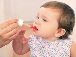 Administrer un médicament à un enfant